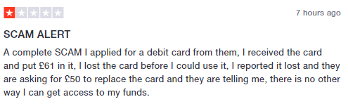 User's review claiming that it's a 'scam'.